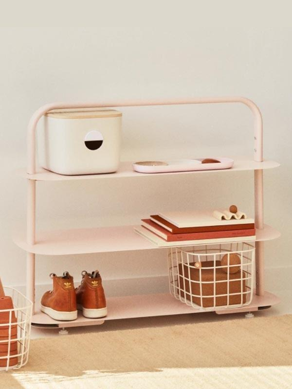 """Turn an unused corner in their home into a functional nook with this visually-pleasing entryway rack. It can be used it to store shoes, bins, or 50 candles. $138, Open Spaces. <a href=""""https://www.getopenspaces.com/shop/entryway-shoe-rack/?variant=32365888765998"""" rel=""""nofollow noopener"""" target=""""_blank"""" data-ylk=""""slk:Get it now!"""" class=""""link rapid-noclick-resp"""">Get it now!</a>"""