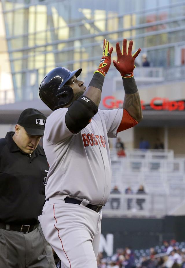 Boston Red Sox designated hitter David Ortiz reacts after his solo home run off Minnesota Twins starting pitcher Kevin Correia during the third inning of a baseball game in Minneapolis, Wednesday, May 14, 2014. (AP Photo/Ann Heisenfelt)