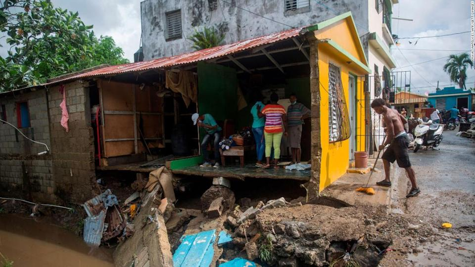 """<p>This home was destroyed by flooding from the Magua River in Hato Mayor, northwest of Santo Domingo, in the Dominican Republic. </p><div class=""""cnn--image__credit""""><em><small>Credit: Erika Santelices/AFP/Getty Images / Getty</small></em></div>"""