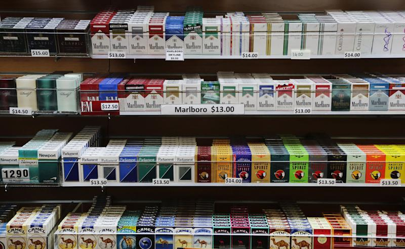 Cigarette packs are displayed at a smoke shop in New York, Monday, March 18, 2013. A new anti-smoking proposal would make New York the first city in the nation to keep tobacco products out of sight in retail stores. Mayor Michael Bloomberg says the goal is to reduce the youth smoking rate. The legislation would require stores to keep tobacco products in cabinets, drawers, under the counter, behind a curtain or in another concealed spot. They could only be visible when an adult is making a purchase or during restocking. (AP Photo/Mark Lennihan)