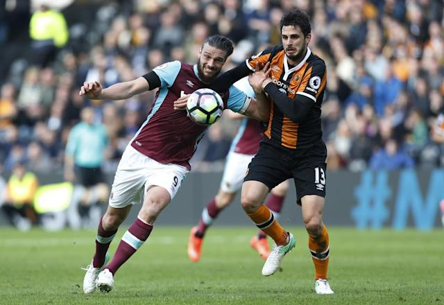 <p>West Ham United's Andy Carroll in action with Hull City's Andrea Ranocchia </p>