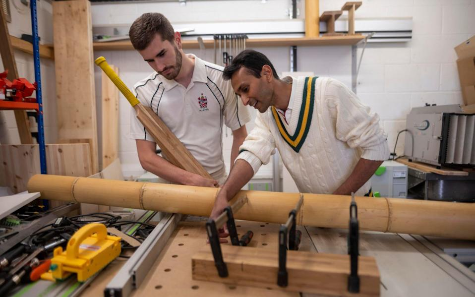 Dr Darshil Shah with Ben Tinkler-Davies in a workshop where the bamboo is made into blocks before it was sent to the cricket bat maker - Paul Grover for the Telegraph
