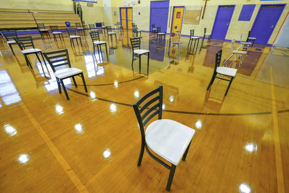 Chairs are spaced 6 feet apart for folks who had COVID-19 vaccinations to be observed, are seen during a news conference at one of New York City Department of Health and Mental Hygiene's COVID-19 Vaccine Hubs at the South Bronx Educational Campus, Saturday, Jan. 9, 2021, in the Bronx borough of New York. (AP Photo/Mary Altaffer)