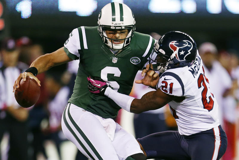 Houston Texans defensive back Brice McCain (21) sacks New York Jets quarterback Mark Sanchez (6) during the second half of an NFL football game Monday, Oct. 8, 2012, in East Rutherford, N.J. The Texans won the game 23-17. (AP Photo/Julio Cortez)