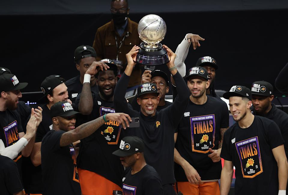 Suns coach Monty Williams holds the Western Conference Championship trophy. (Photo by Ronald Martinez/Getty Images)
