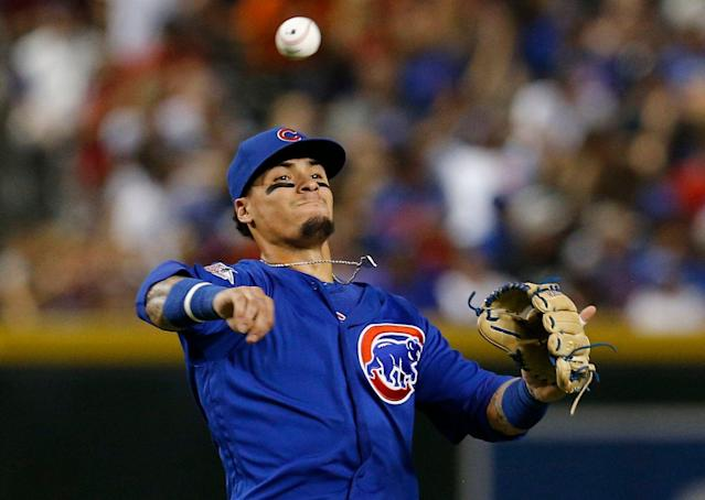 """<a class=""""link rapid-noclick-resp"""" href=""""/mlb/teams/chi-cubs/"""" data-ylk=""""slk:Chicago Cubs"""">Chicago Cubs</a> star <a class=""""link rapid-noclick-resp"""" href=""""/mlb/players/9557/"""" data-ylk=""""slk:Javier Baez"""">Javier Baez</a> is eligible at three positions, which gives his already high stock an added boost. (AP Photo/Rick Scuteri)"""