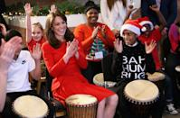 Kate trying out some drumming 'music therapy' at the Anna Freud Centre Family School Christmas Party in 2015. (Chris Jackson - WPA Pool/Getty Images)
