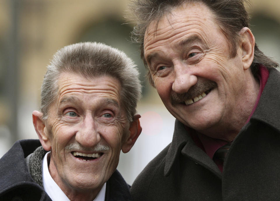 """FILE - This Feb. 3, 2014 file photo shows the Chuckle Brothers, Barry, left, and Paul Elliott in London. British children's entertainer Barry Chuckle, half of sibling duo the Chuckle Brothers, has died aged 73. Manager Phil Dale said Sunday, Aug. 5, 2018 that Chuckle, whose real name was Barry Elliott, died at home after an illness. Barry and his younger brother Paul starred in TV show """"ChuckleVision,"""" which ran on the BBC between 1987 and 2009. (Yui Mok/PA via AP, File)"""