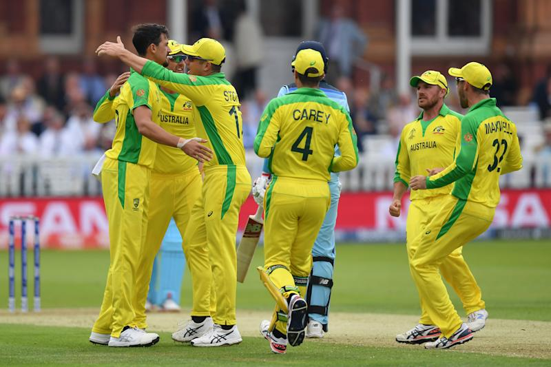Mitchell Starc celebrates with team mates after dismissing Joe Root. (Credit: Getty Images)