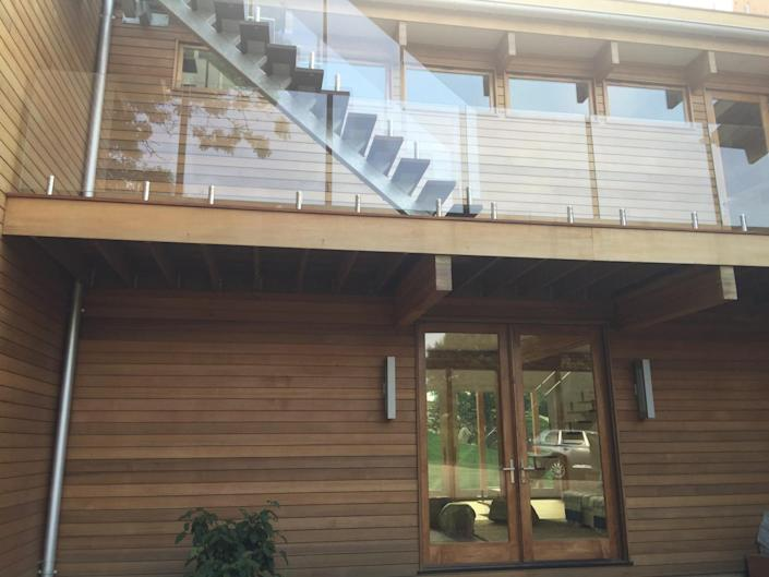 """<p>The house is a customizable kit home put together by <a href=""""http://lindal.com/"""" rel=""""nofollow noopener"""" target=""""_blank"""" data-ylk=""""slk:Lindal Cedar"""" class=""""link rapid-noclick-resp"""">Lindal Cedar</a>. """"You see cedar, you see Douglas fir, you see oak,"""" Laura says of the wood used in the home.<br></p>"""