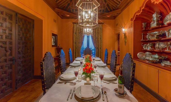 <p>We couldn't help but imagine Thanksgiving dinner in this formal dining room with antique chairs. The ceiling was carved by hand and assembled in Spain, with not one nail used to hold it together. (Photo by Steve Brown/Sepia Productions)</p>
