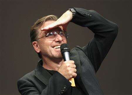 Roth gestures during a ceremony at the Lumiere 2013 Grand Lyon Film Festival in Lyon