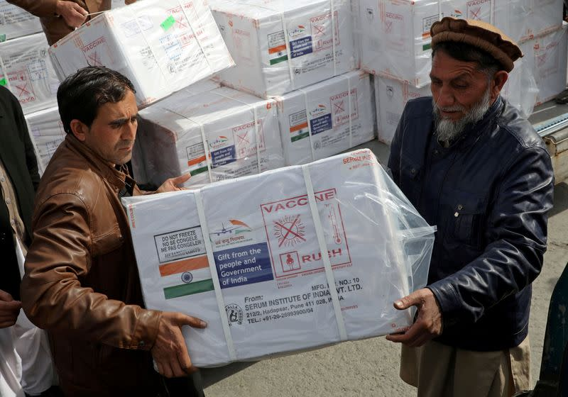FILE PHOTO: Workers from Afghan health ministry unload boxes containing vials of COVISHIELD, a coronavirus disease (COVID-19) vaccine donated by Indian government, in Kabul