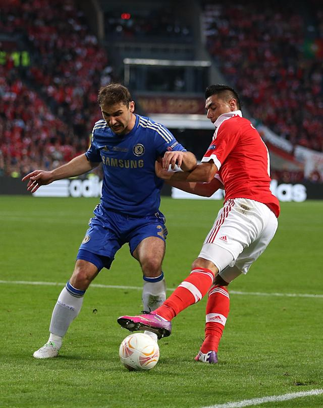 Benfica's Oscar Cardozo (right) and Chelsea's Branislav Ivanovic battle for the ball