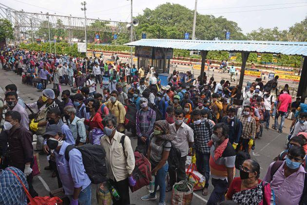 Passengers queue up to enter Howrah station on June 1, 2020 in Kolkata, India.