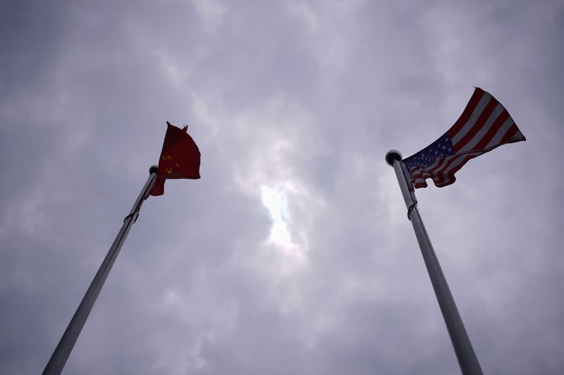 Chinese and U.S. flags flutter in Shanghai