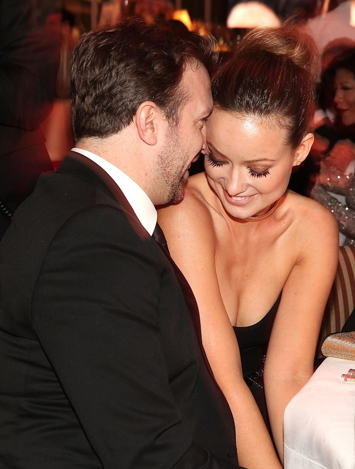 """SNL's"" Jason Sudeikis was caught canoodling with his lady love, ""Tron"" hottie Olivia Wilde. That's one lucky man!"