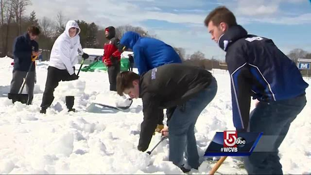 Student athletes in Methuen are laboring to clear the snow from their expensive turf fields with shovels and tarps before the start of the spring sports season.