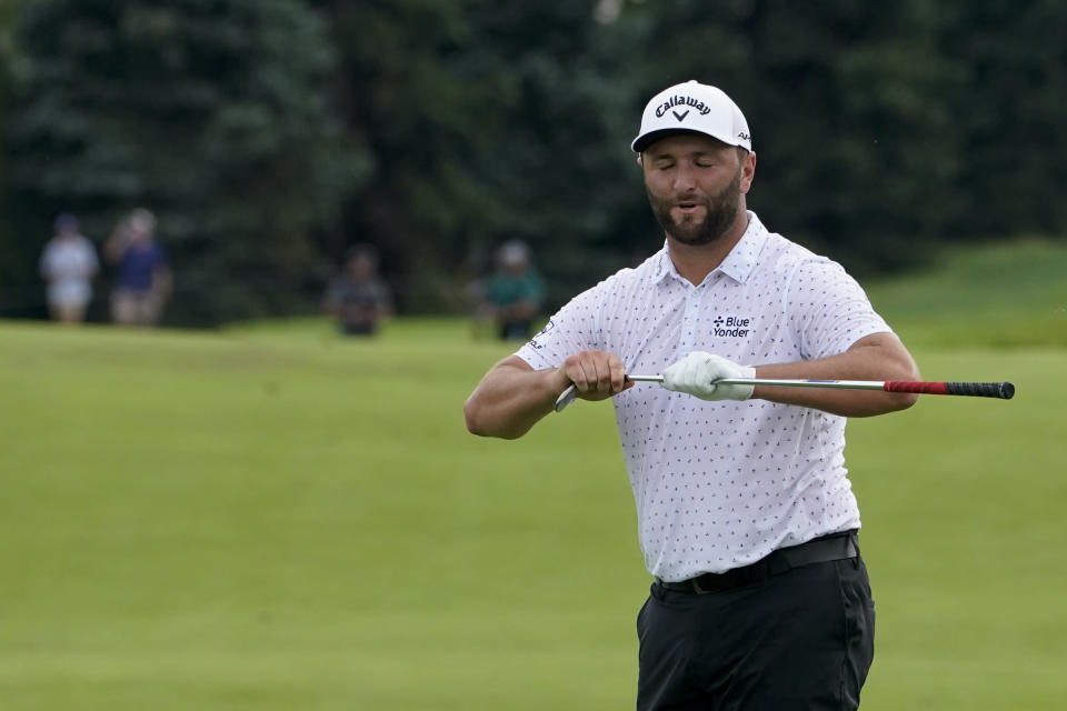 Jon Rahm, of Spain, reacts after missing a birdie putt on the 12th green in the third round at the Northern Trust golf tournament, Saturday, Aug. 21, 2021, at Liberty National Golf Course in Jersey City, N.J. (AP Photo/John Minchillo)
