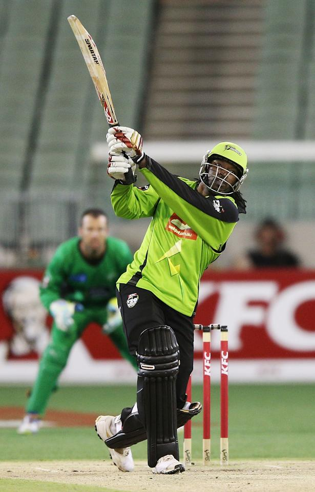 MELBOURNE, AUSTRALIA - JANUARY 08:   Chris Gayle of the Sydney Thunder hits a six during the Big Bash League match between the Melbourne Stars and the Sydney Thunder at Melbourne Cricket Ground on January 8, 2013 in Melbourne, Australia.  (Photo by Michael Dodge/Getty Images)