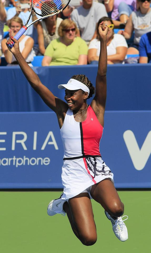 Venus Williams, of the United States, leaps after defeating Samantha Stosur, from Australia, 6-2, 6-7 (2), 6-4, during a quarterfinal at the Western & Southern Open tennis tournament, Friday, Aug. 17, 2012, in Mason, Ohio. (AP Photo/Al Behrman)