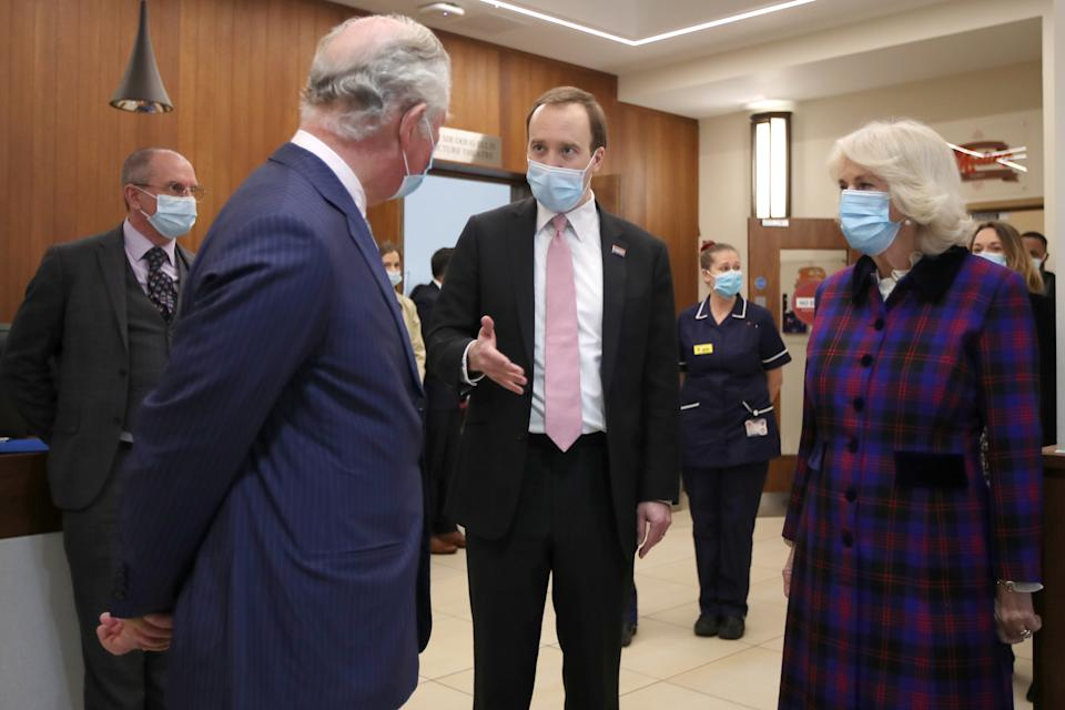 Britain's Prince Charles (L), Prince of Wales and Britain's Camilla (R), Duchess of Cornwall speak with Britain's Health Secretary Matt Hancock during a visit to the Queen Elizabeth Hospital in Birmingham, northern England on February 17, 2021. (Photo by MOLLY DARLINGTON / POOL / AFP) (Photo by MOLLY DARLINGTON/POOL/AFP via Getty Images)