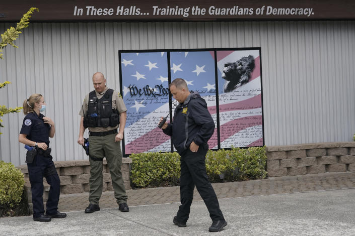 Ken Westphal, right, an officer with the Lacey Police Dept. and an instructor at the Washington state Criminal Justice Training Commission, works with cadets LeAnne Cone, of the Vancouver Police Dept., and Kevin Burton-Crow, right, of the Thurston Co. Sheriff's Dept., during a training exercise Wednesday, July 14, 2021, in Burien, Wash. Washington state is embarking on a massive experiment in police reform and accountability following the racial justice protests that erupted after George Floyd's murder last year, with nearly a dozen new laws that took effect Sunday, July 25, but law enforcement officials remain uncertain about what they require in how officers might respond — or not respond — to certain situations, including active crime scenes and mental health crises. (AP Photo/Ted S. Warren)