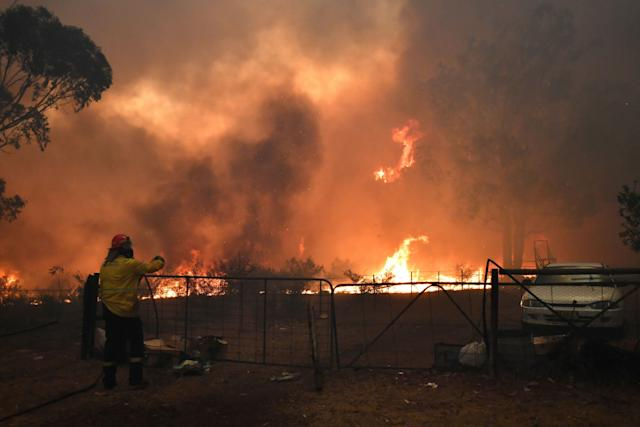 Rural Fire Service (RFS) crews engage in property protection of a number of homes along the Old Hume Highway near the town of Tahmoor as the Green Wattle Creek Fire threatens a number of communities in the southwest of Sydney, Australia. (Photo: REUTERS)
