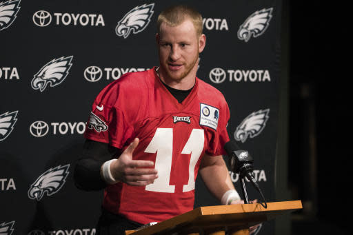 Philadelphia Eagles quarterback Carson Wentz talks to the media prior to practice at NFL football training camp, Tuesday, May 22, 2018, in Philadelphia. (AP Photo/Chris Szagola)