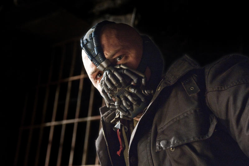 """This undated film image released by Warner Bros. Pictures shows Tom Hardy as Bane in a scene from the action thriller """"The Dark Knight Rises."""" (AP Photo/Warner Bros. Pictures, Ron Phillips)"""