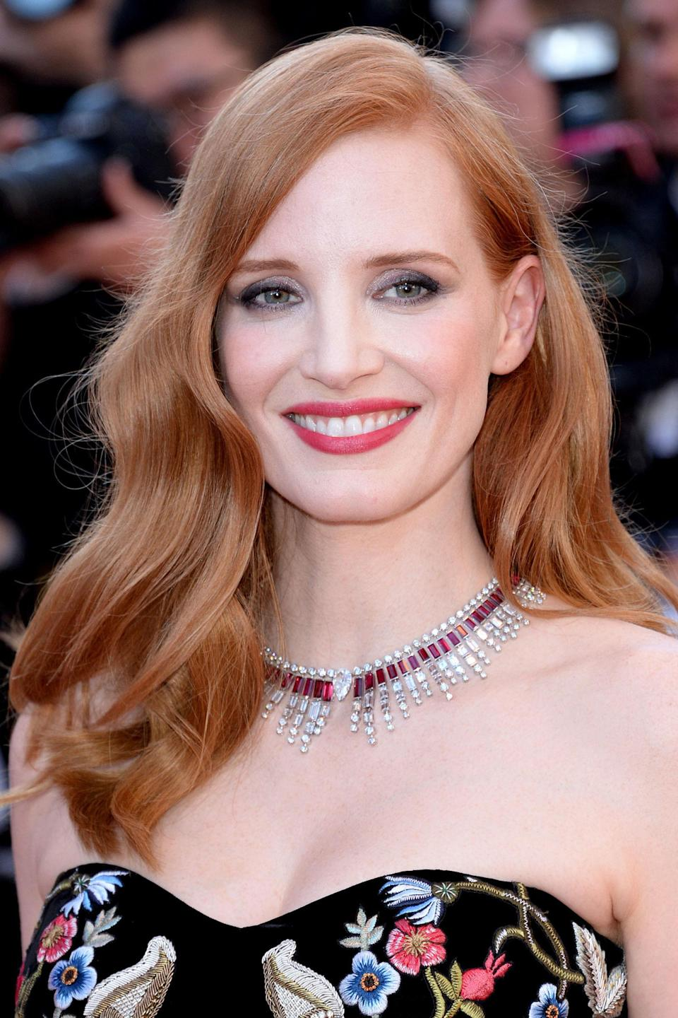 <p>Chastain styled her strawberry red hair in classic, brushed-out waves. Her smoky eye and strong lip combo proves that sometimes more <em>is</em> more.</p>