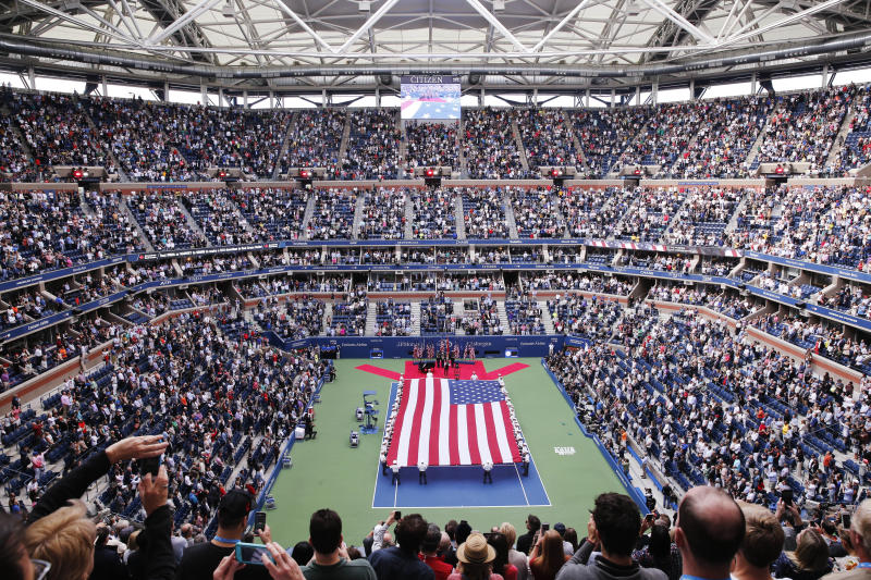 In this file photo from Sept. 10, 2017, cadets from the West Point military academy present the American flag across the court at Arthur Ashe Stadium before the start of the men's singles final of the U.S. Open tennis tournament in New York. New York City's comptroller says the organizers of the U.S. Open tennis tournament owe the city $311,000 in back rent for use of the tournament site in Queens. (AP Photo/Seth Wenig)