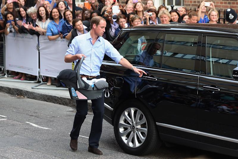 Prince William carries newborn Prince George to the car after his 2013 birth. (Photo: Getty Images)