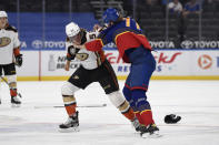 Anaheim Ducks' Max Comtois (53) gets physical with St. Louis Blues' Niko Mikkola (77) during the first period of an NHL hockey game on Wednesday, May 5, 2021, in St. Louis. (AP Photo/Joe Puetz)