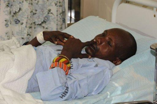 A policeman lies on a hospital bed in Nairobi recounting how he and others were attacked in Baragoi