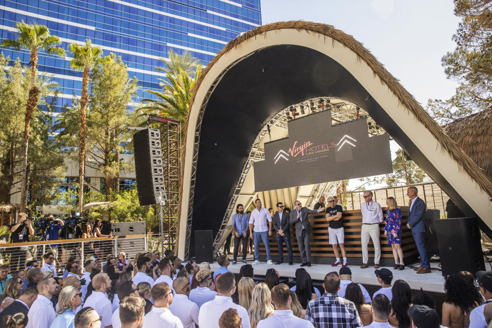 """Sir Richard Branson, fourth from right, founder of Virgin Group, is introduced by Richard """"Boz"""" Bosworth, owner of Virgin Hotels Las Vegas, during the """"Unstoppable Weekend"""" kickoff party at Virgin Hotels Las Vegas on Thursday, June 10, 2021. (Benjamin Hager/Las Vegas Review-Journal via AP)"""