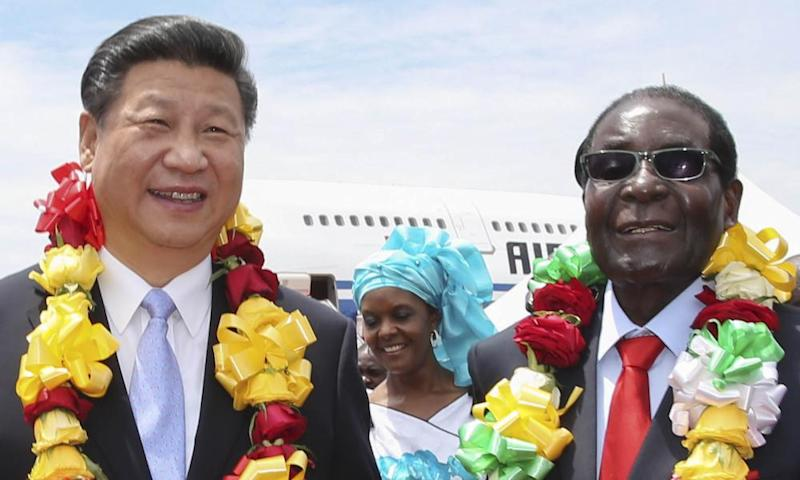 Robert Mugabe, right, with the Chinese president, Xi Jinping, in Harare