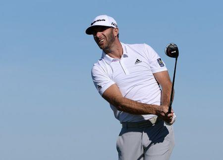 Feb 9, 2018; Pebble Beach, CA, USA; Dustin Johnson watches his shot from the 13th tee box during the second round of the AT&T Pebble Beach Pro-Am golf tournament at Monterey Peninsula Country Club - Shore Cours. Mandatory Credit: Orlando Ramirez-USA TODAY Sports