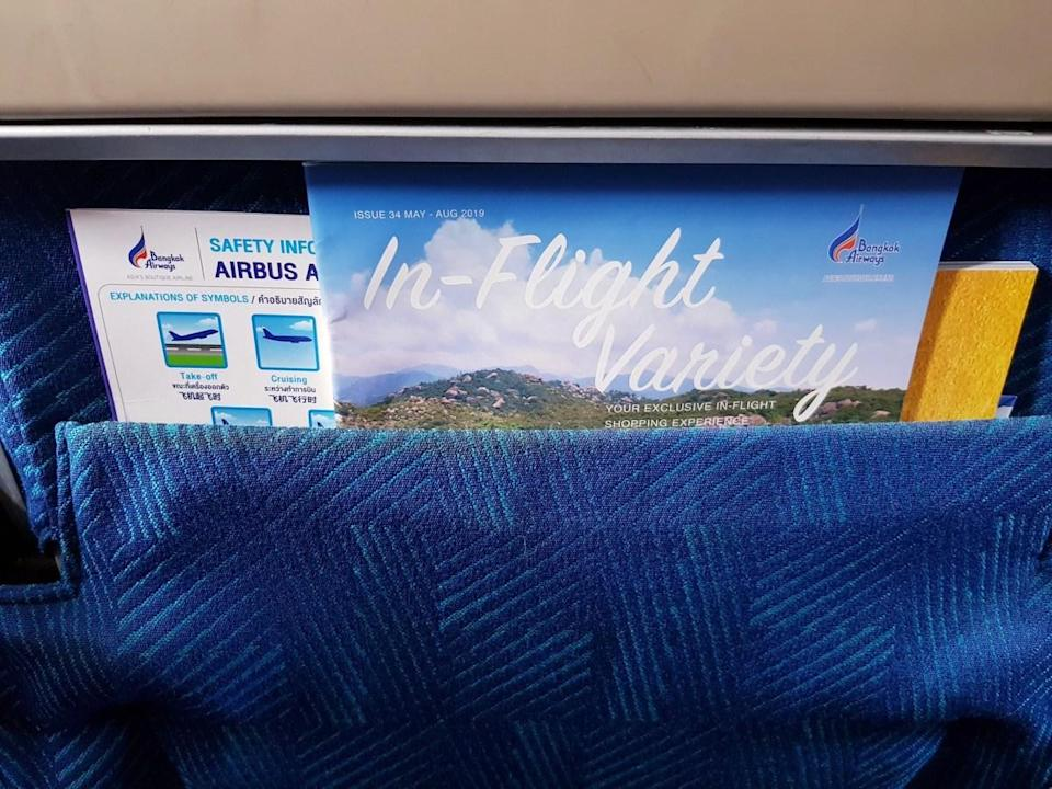 """It's tempting to reach into the seat-back pocket and peruse the in-flight magazine while you're waiting for takeoff, but that might not be the best idea. Why? Simple: """"Most people lick their fingers before turning a page,"""" says <strong>Cindy Richards</strong>, an editor for <a href=""""https://www.travelingmom.com/"""" rel=""""nofollow noopener"""" target=""""_blank"""" data-ylk=""""slk:TravelingMom.com"""" class=""""link rapid-noclick-resp"""">TravelingMom.com</a>. Yeah… We'll stick with the latest <strong>James Patterson</strong> novel, instead."""