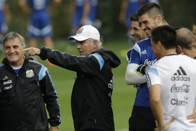 Argentina's head coach Alejandro Sabella, center, speaks to players during a training session in Vespesiano, near Belo Horizonte, Brazil, Thursday, July 10, 2014. On Sunday, Argentina faces Germany for the World Cup final soccer match in Rio de Janeiro. (AP Photo/Victor R. Caivano)