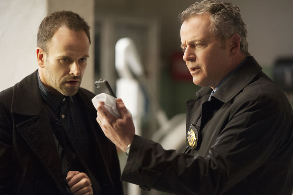 """Heroine"" - Sherlock (Jonny Lee Miller, left) and Gregson (Aidan Quinn, right) once again find themselves in the crosshairs of the enigmatic Moriarty, on the two-hour season finale of ""Elementary."""