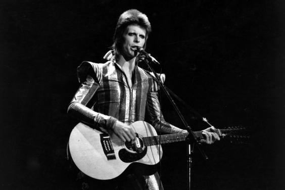 David Bowie performs his final concert as Ziggy Stardust at the Hammersmith Odeon in 1973 (Getty)