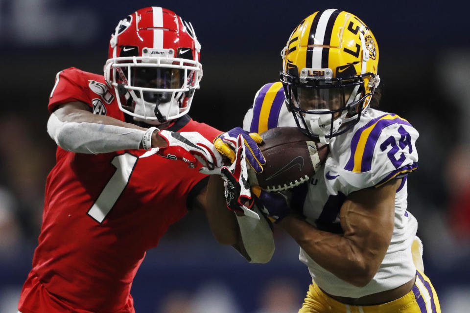 FILE - In this Dec. 7, 2019, file photo, LSU cornerback Derek Stingley Jr. (24) intercepts a throw to Georgia wide receiver George Pickens (1) during the second half of the Southeastern Conference championship NCAA college football game in Atlanta. Stingley was selected to The Associated Press Preseason All-America first team defense, Monday Aug. 23, 2021. (AP Photo/John Bazemore, File)
