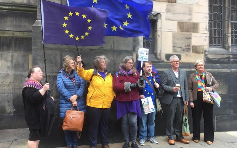 Flying the flag: SNP MP Joanna cherry (right) alongside Jo Maugham QC with pro-EU campaigners outside the Court of Session in Edinburgh - PA