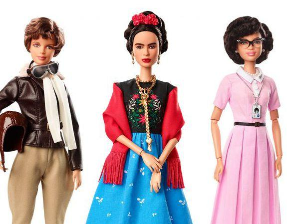 Frida Kahlo, Amelia Earhart, and Katherine Johnson Barbie dolls.