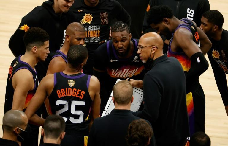 Phoenix Suns coach Monty Williams, front right, talks with his team during game two of the NBA Finals