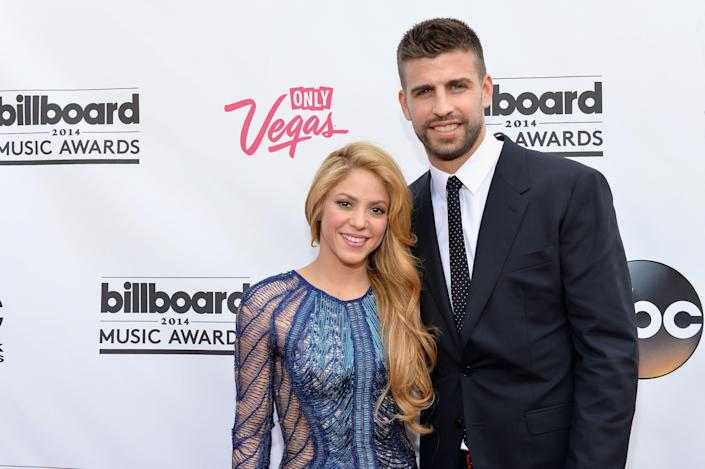 """<p>Despite his fame as a soccer star playing for FC Barcelona, Shakira had never even heard of Gerard Pique. """"I wasn't a soccer fan so I didn't know who he was,"""" she said in a 2020 <em><a href=""""https://www.cbsnews.com/news/shakira-prepares-for-super-bowl-halftime-show-60-minutes-2020-01-05/"""" rel=""""nofollow noopener"""" target=""""_blank"""" data-ylk=""""slk:60 Minutes interview"""" class=""""link rapid-noclick-resp"""">60 Minutes interview</a></em>. But when she spotted him during his one-second cameo in her music video for """"Waka Waka (This Time For Africa),"""" the 2010 World Cup anthem, she remembers saying, """"Hmm. That one's kind of cute."""" </p><p>The pair's been together since 2011, welcomed their first son, Milan, in 2013, and their second, Sasha, in 2015. Despite their years long commitment to each other, Shakira says there are no wedding bells in their future. They're happy with the way things are. """"We already have what's essential, you know?"""" she told <em><a href=""""https://www.glamour.com/story/shakira-glam-belleza-latina-cover"""" rel=""""nofollow noopener"""" target=""""_blank"""" data-ylk=""""slk:Glamour"""" class=""""link rapid-noclick-resp"""">Glamour</a></em> in 2014. """"I think that those aspects of our relationship are already established, and marriage is not going to change them. But if I'm ever going to get married, he's the one.""""</p><p>In fact, the couple's embraced their relationship dynamic. I don't want [Gerard] to see me as the wife. I'd rather him see me as his girlfriend,"""" Shakira told <em>60 Minutes</em>. """"It's like a little forbidden fruit, you know?"""" she adds laughing. """"I wanna keep him on his toes. I want him to think that anything's possible depending on behavior."""" </p><p>This exciting energy Shakira and Gerard have been able to maintain during their 10 years together comes through in how they interact, according to <a href=""""https://karendonaldsoninc.com/"""" rel=""""nofollow noopener"""" target=""""_blank"""" data-ylk=""""slk:Karen Donaldson"""" class=""""link rapid-noclick-resp"""">Karen Donaldson</a>, a body languag"""