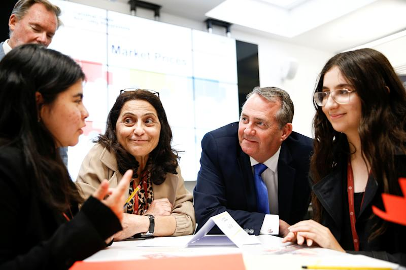 Britain's Secretary of State for International Trade Liam Fox visits students taking part in a mock trade negotiation at Harris Westminster Sixth Form college in central London, Britain July 10, 2019. Picture taken July 10, 2019. REUTERS/Henry Nicholls