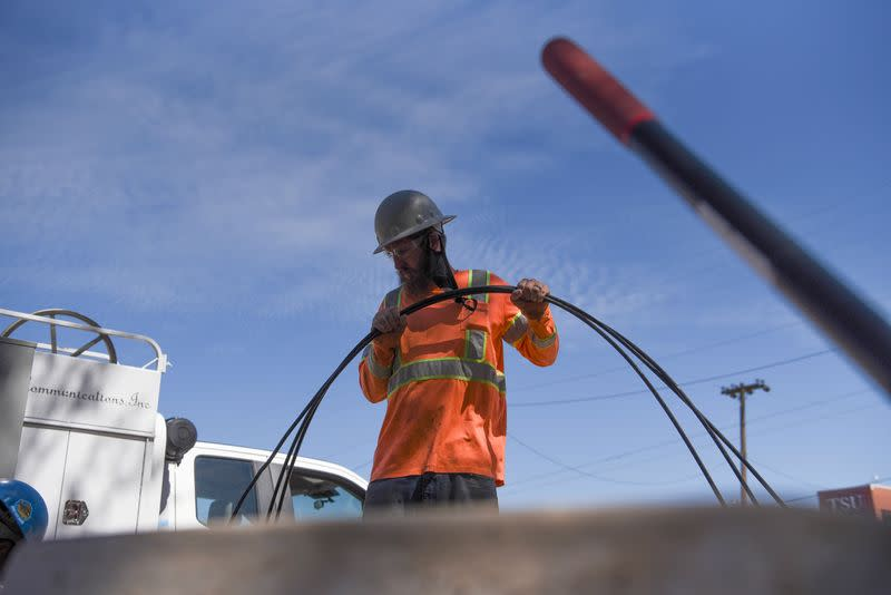 FILE PHOTO: A power crew works to restore 5G in Houston
