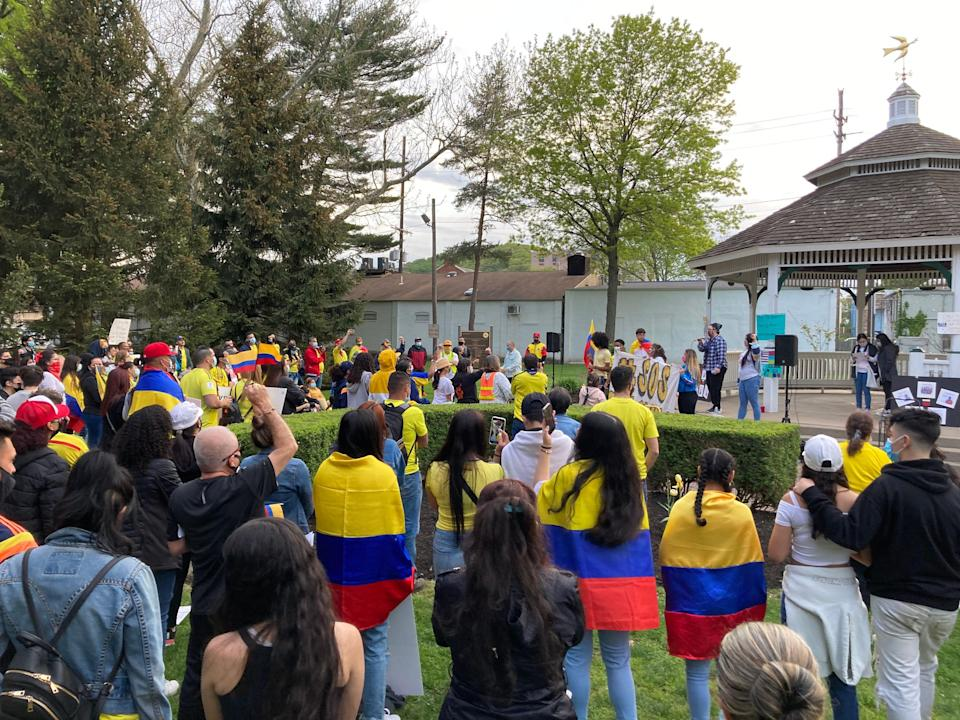 A few dozen people attended a rally in Dover on Friday to stand in solidarity with the residents of Colombia.